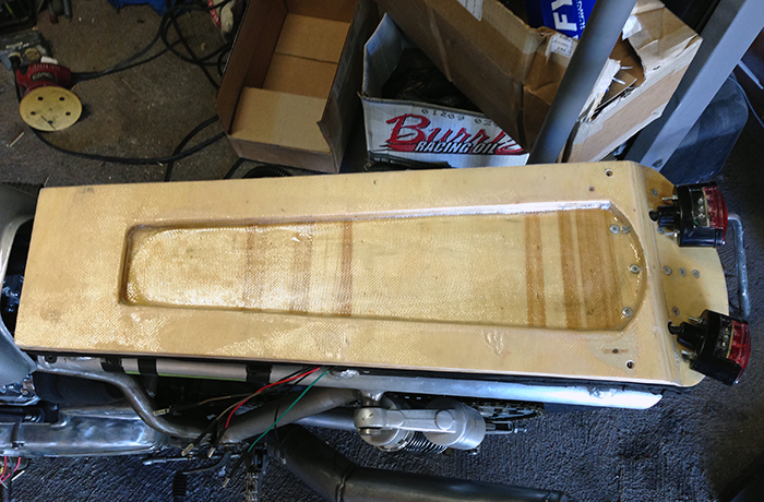 The seat pan glassed and trimmed. It is now ready for covering.