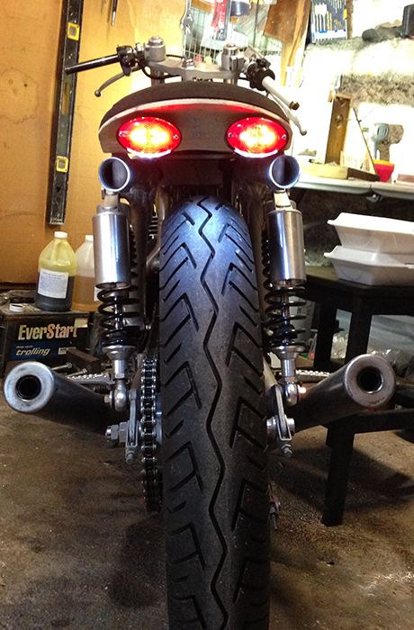 The tail lights are temporarily mounted. They show with the running lights on here.