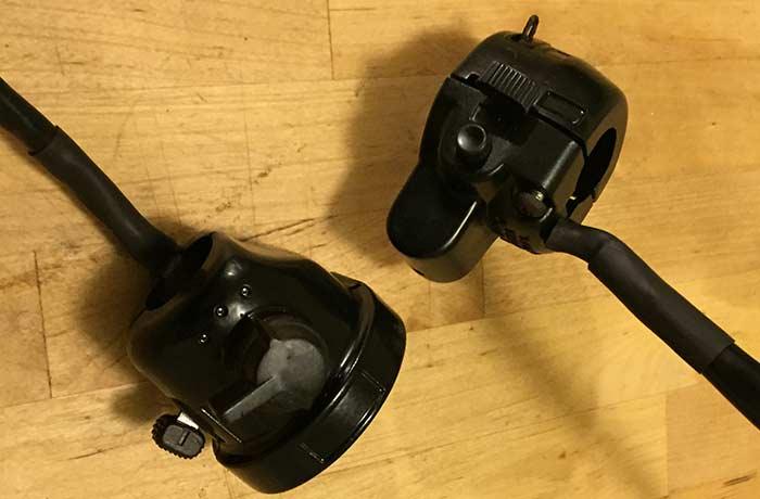 Freshly powder coated and reassembled handlebar controls.