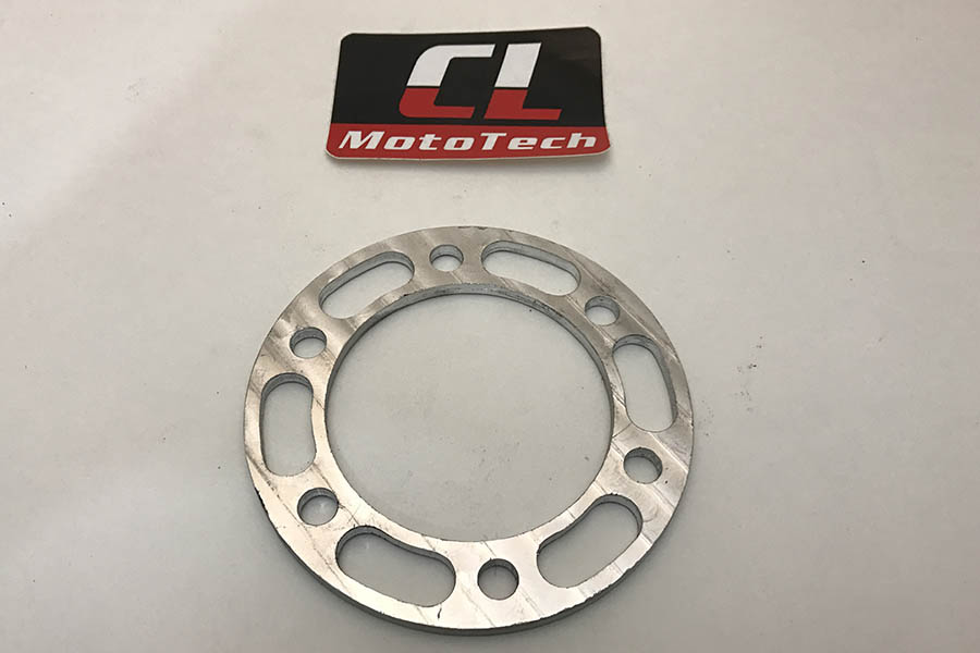 A thin brake spacer to adapt a brake rotor to different forks.