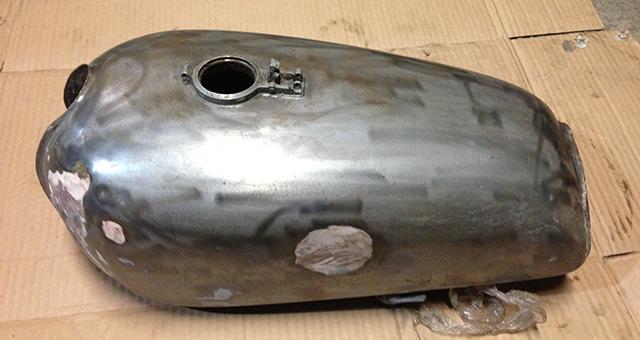 Gas tank showing some body filler.
